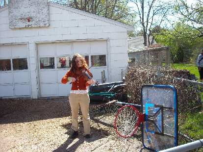 Another woman came and played the fiddle at various coops we visited.