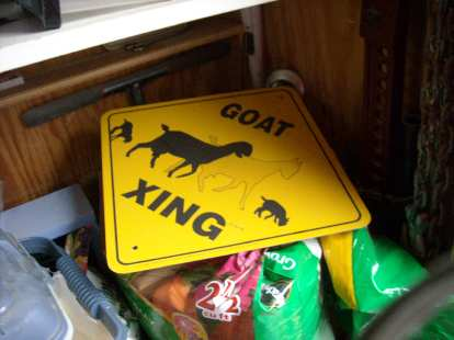 """Goat xing.""  There were no goats around but perhaps the chicken owner had plans for goats in the future."