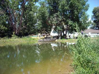 """A pond and boat, good for Luke's """"Tom Sawyer-like son."""""""
