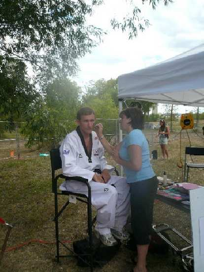 Tim getting face-painted.