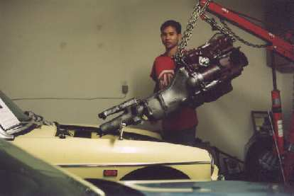 [May 5, 2002] Installing her newly-rebuilt engine.