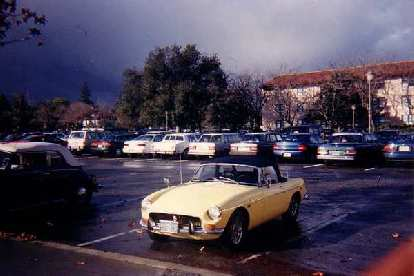 [January 1996] Goldie in the Stanford parking lot, a couple of months after I bought her.  Note the 1970 grille.  In half-a-year, I'd replace it with an early style, chrome ribbed one.