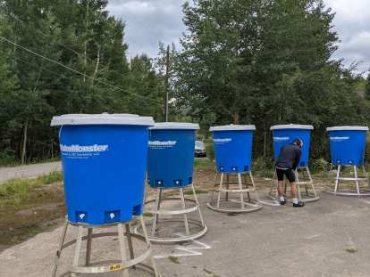 These blue WaterMonster hydration dispensers provided an efficient way for cyclists to refill their bottles with water.
