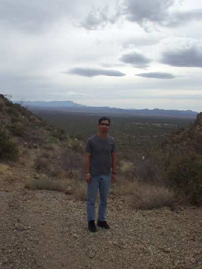 Felix Wong in Saguaro National Park, looking very dark and sunburned after Ironman Arizona the previous day.
