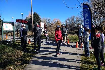 Volunteers and runners at the end of the 2017 Turkey/Donut Predict 5k at Rolland Moore Park.