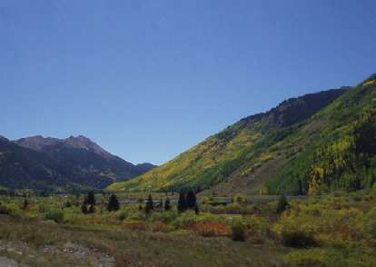 A lake, yellow aspen, rocky mountains... you have it all here.