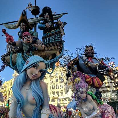 A falla of sailors gawking at a very attractive blue-haired woman.