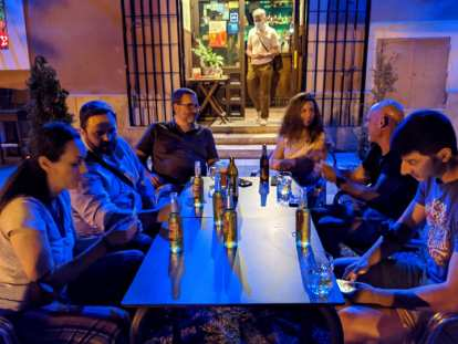 Nieves, Victor, Angel, Lydia, Gerald, and Ismael enjoying late night drinks.