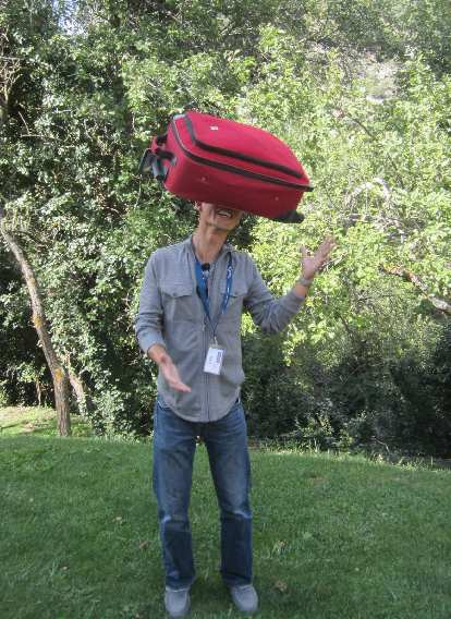 Felix Wong balancing a suitcase on his forehead.