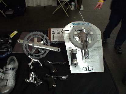 """At VeloSwap--the nation's largest annual bicycle swap meet and show--at the Cow Palace in SF was Shimano.  Apparently, Ultegra this year has went the way of Dura Ace for the crankset, which to me, still looks aesthetically-questionable and rather Darth-Vader-like.  """"It's like a woman without a belly button!"""" I recalled someone posting on a Usenet newsgroup."""