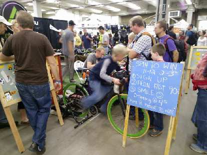 A kid participating in the fast pedaling competition.