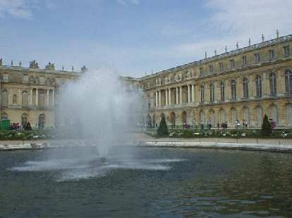 Closeup of a fountain, and rear view of L'Chateau.