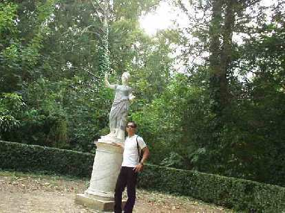 Felix Wong with one of the many statues in the gardens.