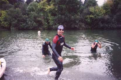 [Swim Mile 2.4, 1:51:xx elapsed] I actually felt good on the swim, though... just slow!  Here I am emerging from the water... the purple swim cap signifies that I was part of the under-40yo wave.