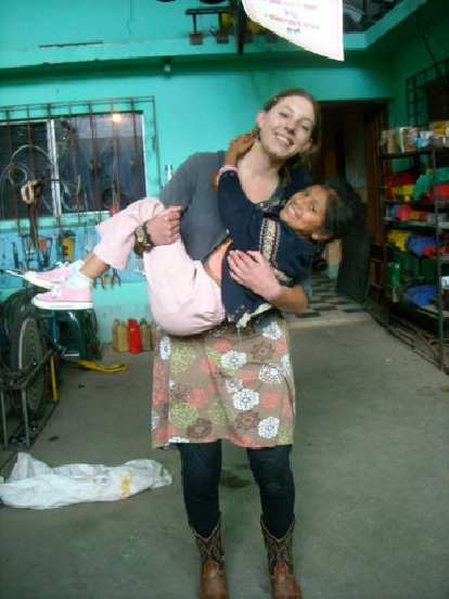 Michelle and Kimberley, one of the super affectionate local children.