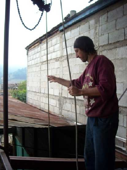 Bruce helping lower a bicimaquina from the roof.
