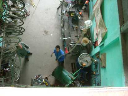 The experimental bicilavadora (bicycle washing machine) being lowered down to the shop floor.