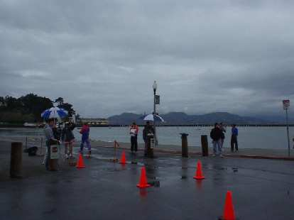 The rain paused just long enough to give near-ideal running conditions.  Here are some spectators, with the Golden Gate Bridge in the background.
