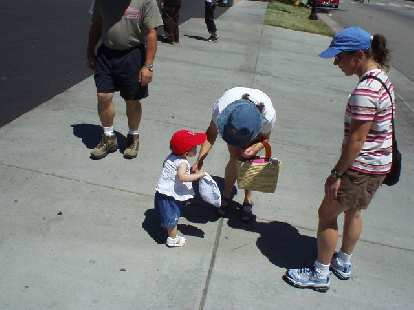 Aw, what a cute little boy in a red baseball cap, said a passerby.  No, not a boy... that's cute little Emmalee!