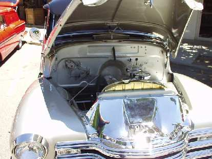 Art work was not limited to the exteriors, as evidenced by this nudie under the hood.