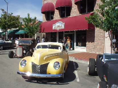 A handsome two-door in front of the Chocolate Factory.