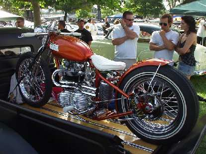 An elegant Triumph motorcycle on a pickup bed.