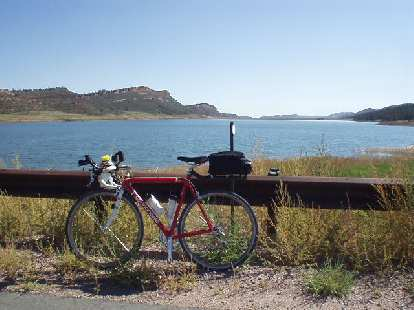 [Mile 121, 2:17] Yes, I love my bike.  Canny in front of an unnamed lake.