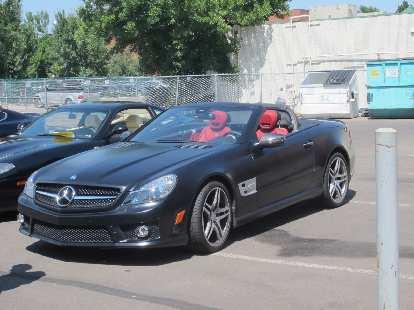 A 2012 Mercedes SL550 in matte black.