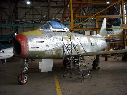 A plane under restoration inside the museum at the back.