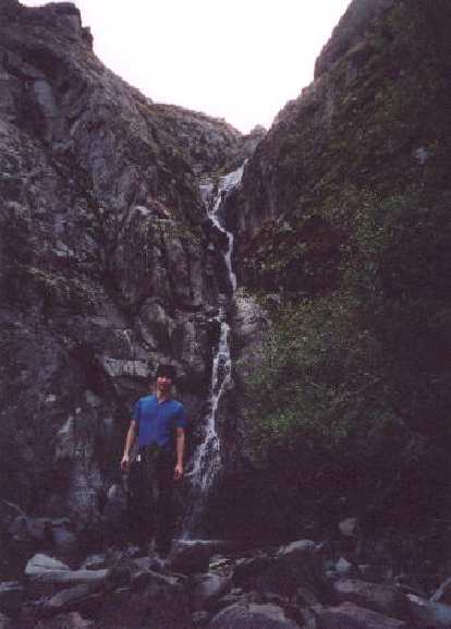 [Ohlone Wilderness Trail, Jan 2002] Felix Wong with the falls in the background.