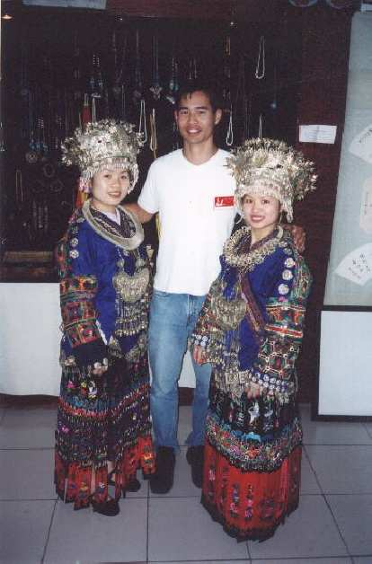 That's me with two ethnic-minority sisters, who had just danced, sung, and played musical instruments for us in Yueyang.