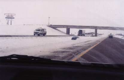 One of the many cars buried under snow along I-80.