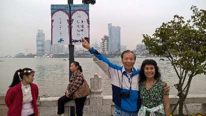 My dad and mom on the island of Gulangyu, with Xiamen in the background.