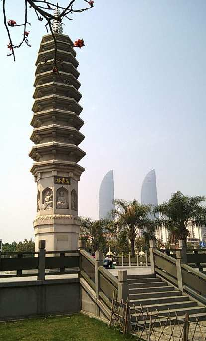 Pagoda near Xiamen University, with two leaf-shaped buildings in the background.