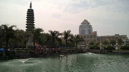 Pagoda and pond in Xiamen, with Xiamen University in the background.