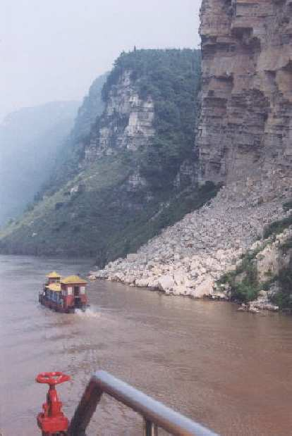 Passing a cute little boat on the Yangtze.  This was before we started spotting dead pigs in the water!