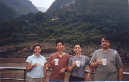 """Karen, Felix, Martrese, and John drinking coffee or tea out of their """"parting gifts""""."""