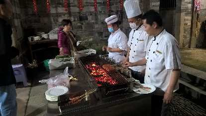 There were cooks barbecuing meat and vegetables inside the Yongding Hakka Tulou.