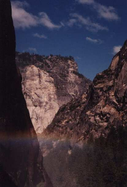 Another pretty rainbow overshadowed by the towering cliffs of Yosemite.