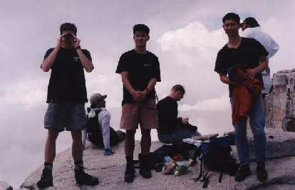 That's Scott, Dave, and I after taking an hour's nap at the top of Half Dome! Mike was up there too, somewhere...