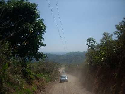 Motoring up a dirt road to the zip-lines.