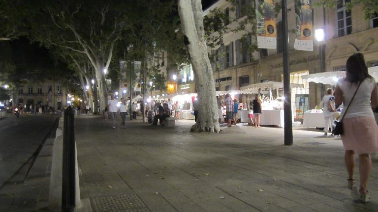 Checking out the vendors with Katia on Cours Mirabeau at night.
