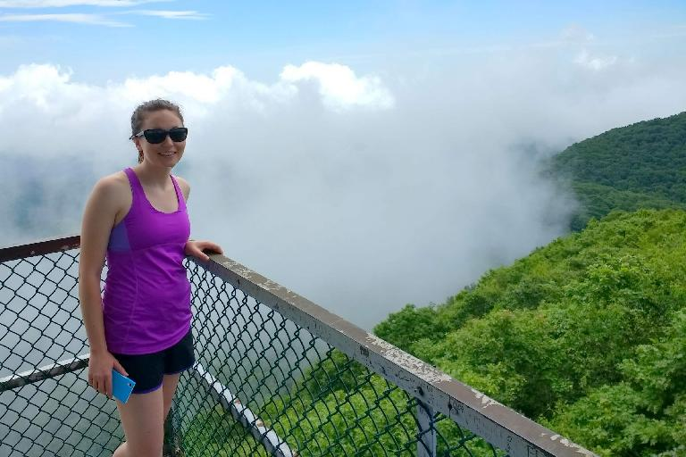 Maureen on the lookout tower at Albert Mountain and above the fog.