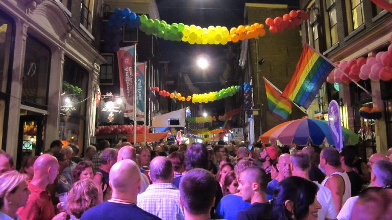 The night before the Gay Pride Parade had lots of people out in the streets.