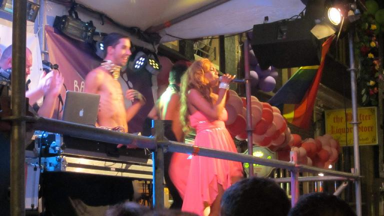Singer and dancer on the night before the Gay Pride Parade.