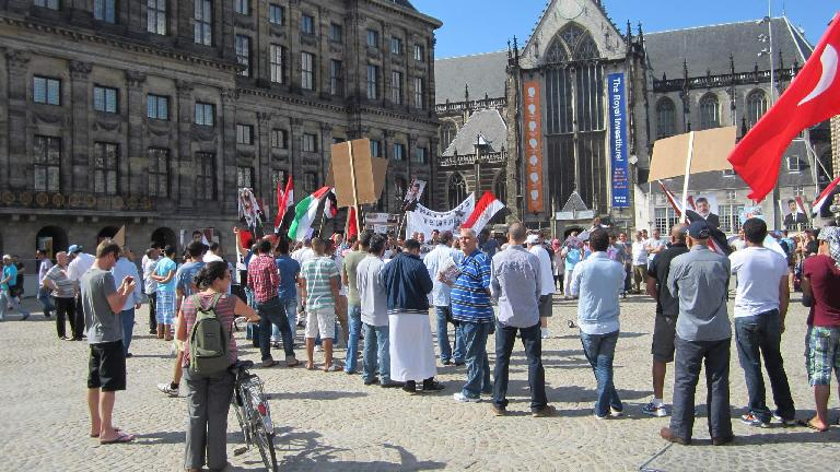 Some sort of protest was happening in front of the Royal Palace in Amsterdam.