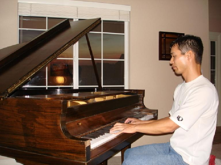 Felix Wong on the piano with a nice sunset out the window. Photo: Ann Podbielski.