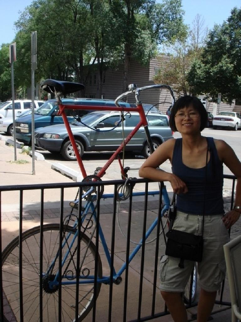 Stacey with a double-decker bicycle parked next to Jeju's. Photo: Ann Podbielski.