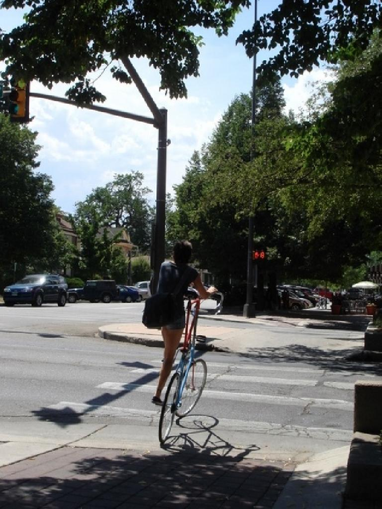 The owner (a girl!) of the double-decker bike rides away. Photo: Ann Podbielski.