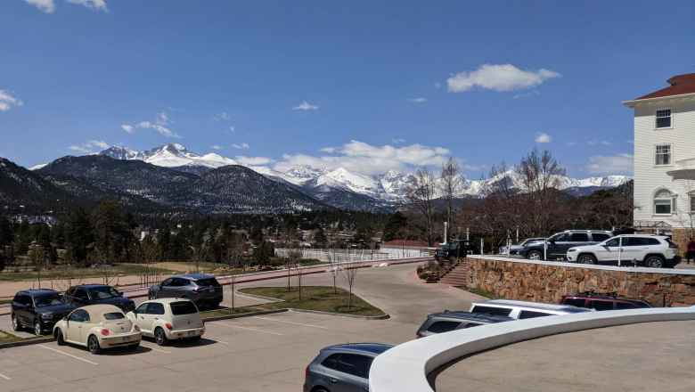 The view of the snow-covered Rocky Mountains from the Stanley Hotel in Estes Park.